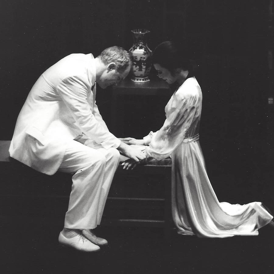 John Lithgow and B.D. Wong hold hands in M. Butterfly.