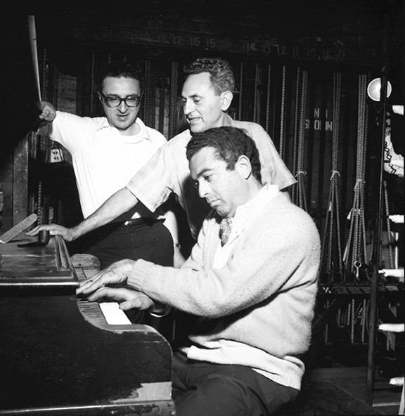 Sheldon Harnick watches as Jerry Bock plays the piano and Joseph Stein gives directions.