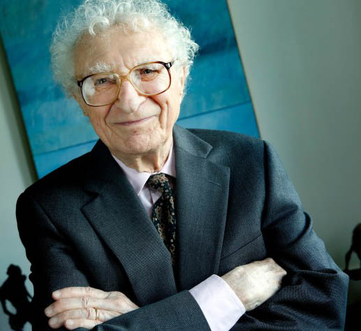Sheldon Harnick crosses his arms and gives a small smile to the camera.