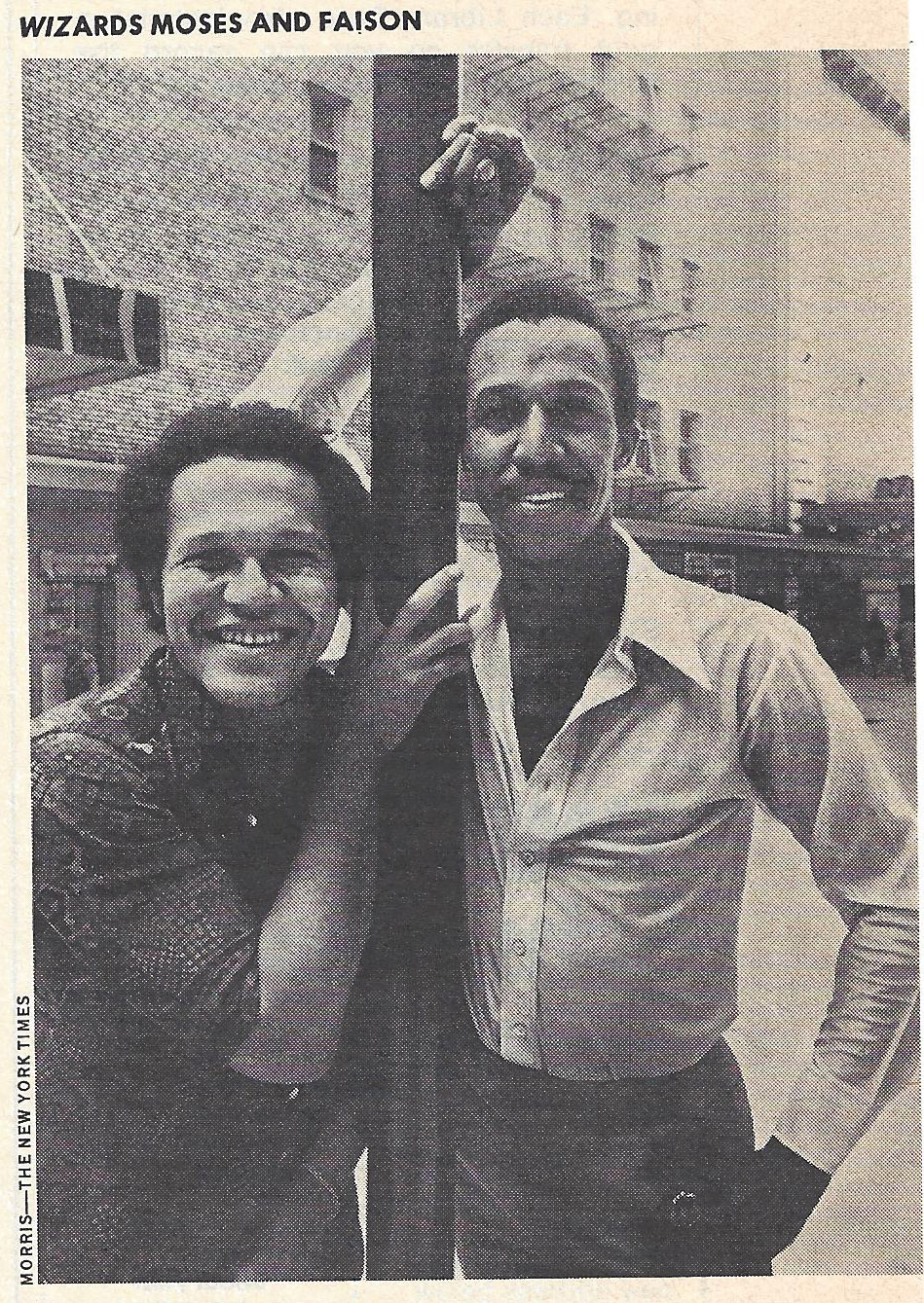 Gilbert Moses and George Faison pose for a newspaper photograph.