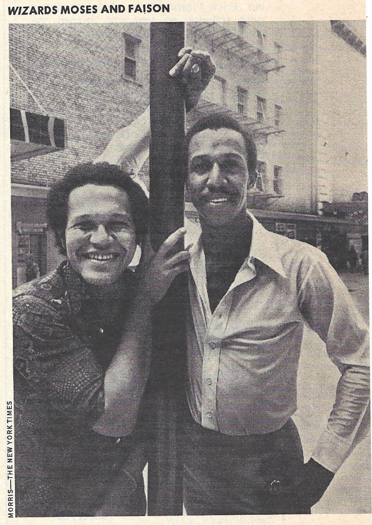 Gilbert Moses and George Faison pose for a photograph and smile into the camera.