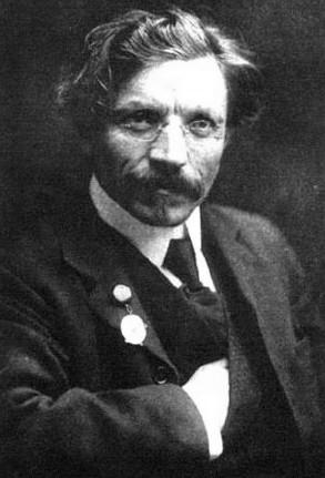 A black and white photograph of Sholem-Aleichem posing for a portrait.