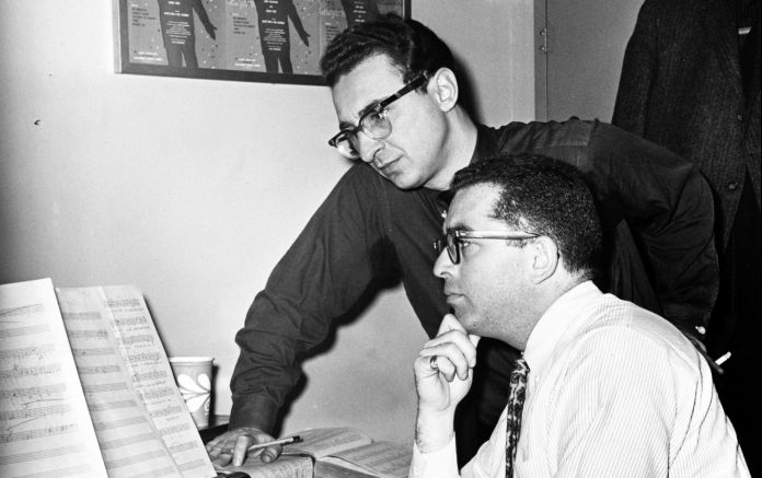 Sheldon Harnick and Jerry Bock work at the piano.